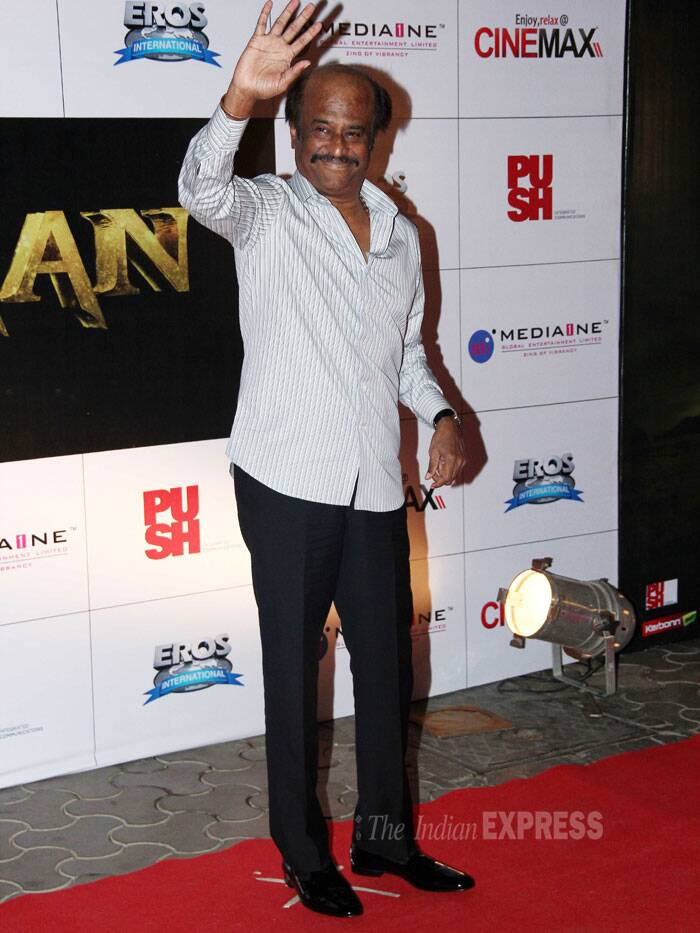 The star of the night, Rajinikanth waves to his dear fans. The actor will be seen romancing Deepika Padukone in 'Kochadaiiyaan', which has been directed by his younger daughter, Soundarya. (Photo: Varinder Chawla)