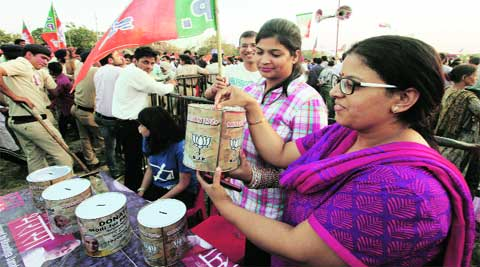 Volunteers collect donations during the BJP rally at Exhibition Ground in Sector 34, Chandigarh, on Saturday.  (IE photo: Jasbir Malhi)