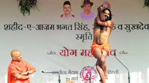 BJP's PM candidate Narendra Modi had spoken at Ramdev's (right) yoga mahotsav held at Ramlila Maidan on Sunday. (Photo: Ravi Kanojia)