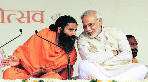 Ramdev with Narendra Modi at the Yoga Mahotsav Sunday. Ravi Kanojia