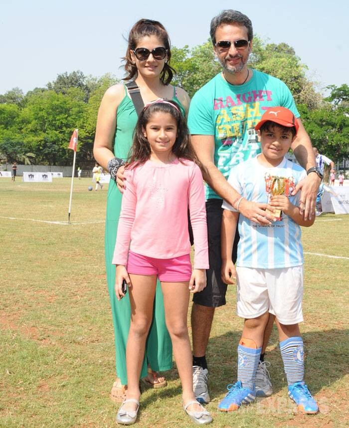 Actress Raveena Tandon, who will be soon seen in 'Bombay Velvet', was spotted with her husband Anil Thadani cheering for their kids - Rasha and Ranbir at the Junior Football Championship League (JFC) in Mumbai on Monday (March 31). (Photo: Varinder Chawla)