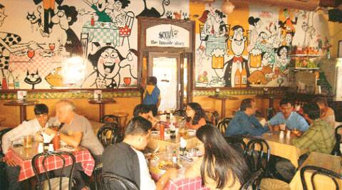 Hip and happening Business as usual at the Cafe Mondegar in Colaba Causeway.