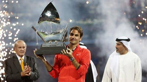Roger Federer of Switzerland poses with the trophy after defeating Tomas Berdych of the Czech Republic in their men's singles final (Reuters)
