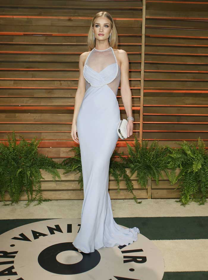 Rosie Huntington-Whiteley was classy in light lavander gown with a sheer bodice. (Reuters)