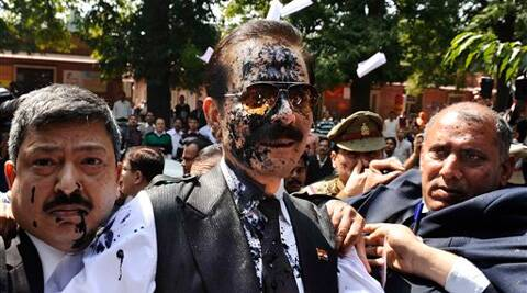 A lawyer threw ink at the top Indian businessman as he arrived at India's highest court Tuesday to face charges that his company failed to return billions of dollars to investors. (AP)