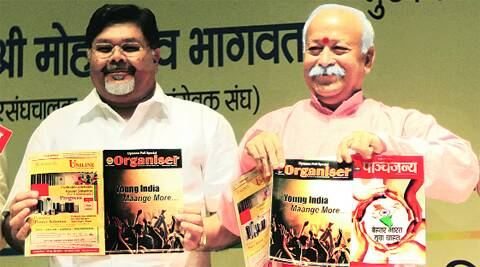 Express chairman Viveck Goenka and RSS chief Mohan Bhagwat in New Delhi on Monday.  Amit Mehra