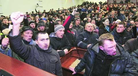 Pro-Russian demonstrators hold a meeting inside the regional government building in Donetsk. REUTERS