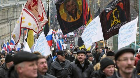Some of the more than ten thousand of pro-Kremlin demonstrators holding a Russian flags march in central Moscow, Russia. (AP)