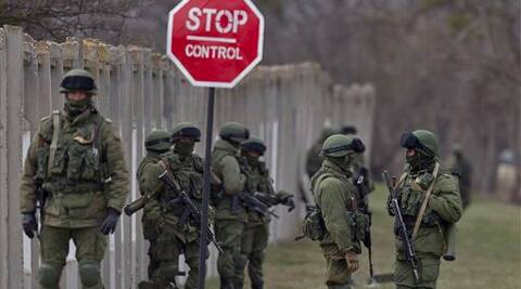 Pro-Russian soldiers stand outside a Ukrainian army base in Crimea. (AP)