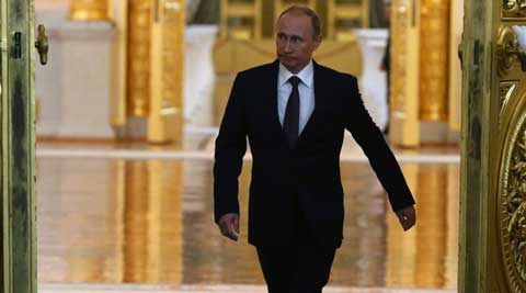 President Vladimir Putin added Crimea to the map of Russia on Tuesday, describing the move as correcting past injustice. (AP Photo)