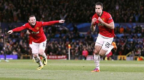 Manchester United's Robin van Persie, right, celebrates scoring their third goal, and his hat-trick against Olympiakos, with team-mate Wayne Rooney (AP)