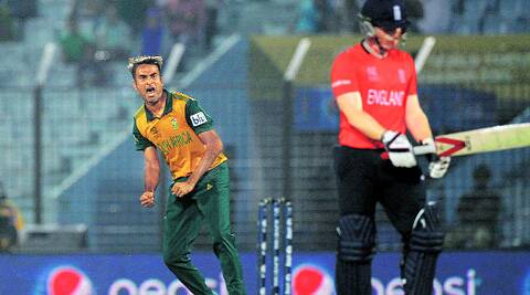 South Africa's Imran Tahir celebrates the dismissal of England's Eoin Morgan during their Group One match in Chittagong on Saturday. (AP)