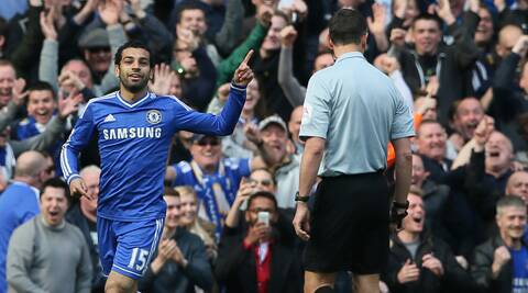 Chelsea's Mohamed Salah celebrates after scoring his sides 6th goal of the game during their English Premier League soccer match between Chelsea and Arsenal at Stamford Bridge stadium in London. (AP)