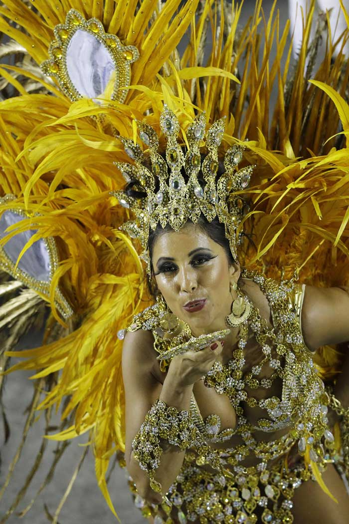 """Samba is the root that binds Brazilian culture,'' said Nanny Kammura, a 35-year-old kindergarten teacher and mother who transforms into a ""passista'' samba dance specialist for the Mocidade school when the big party rolls around each year. (AP)"