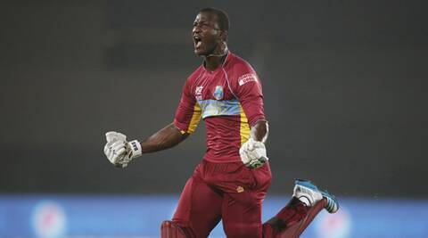 West Indies' captain Darren Sammy runs to celebrate his team's win over Australia in the ICC T20 Cricket World Cup match in Dhaka. (AP)