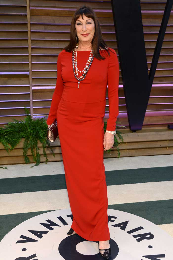 Red at Vanity! While the red worked in favour of Sienna Miller, it failed to impress for Anjelica Huston. (Reuters)