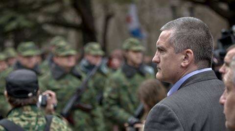 "Crimean Premier Sergei Aksyonov, right, attends the swearing in ceremony for the first unit of a pro-Russian armed force, dubbed the ""military forces of the autonomous republic of Crimea"" in Simferopol, Ukraine. (AP)"
