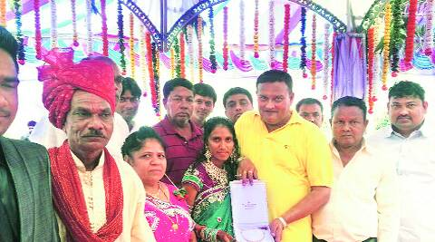 Retired school principal Ishwar Patel (in turban) at his daughter's wedding at Ambach in Valsad. express