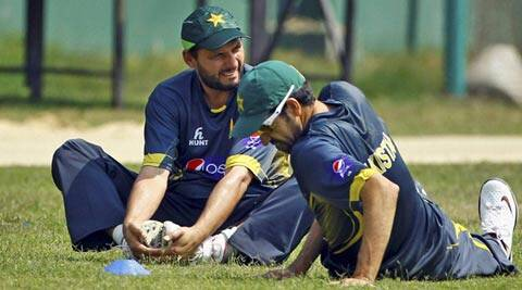 Pakistan's Shahid Afridi and Umar Gul stretch during a practice session in Dhaka on Friday (AP)