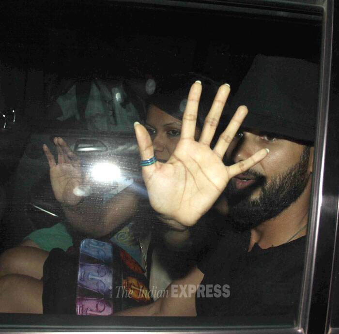 Shahid's manager tries her best to keep the actor from getting snapped as they leave in his car. (Photo: Varinder Chawla)