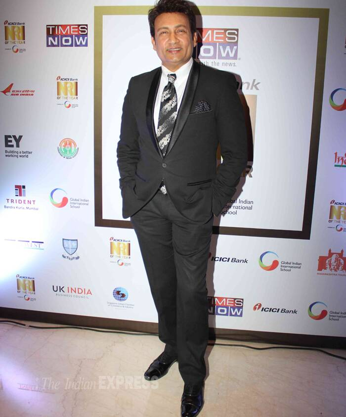 Talk-show host turned director Shekhar Suman was suave in a black suit. (Photo: Varinder Chawla)