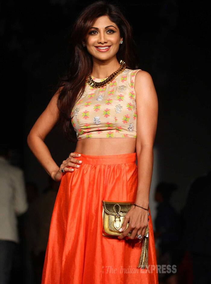 Meanwhile a host of celebs cheered for their favourite designers. <br /> Shilpa Shetty was her usual sultry self in the black skirt and embroidered choli-top. (IE Photo: Dilip Kagda)