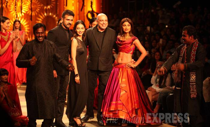 Designer Tarun Tahiliani joins his showstoppers - Shilpa, Harman and Ayesha - on the ramp before the end of the show. (IE Photo: Amit Mehra)
