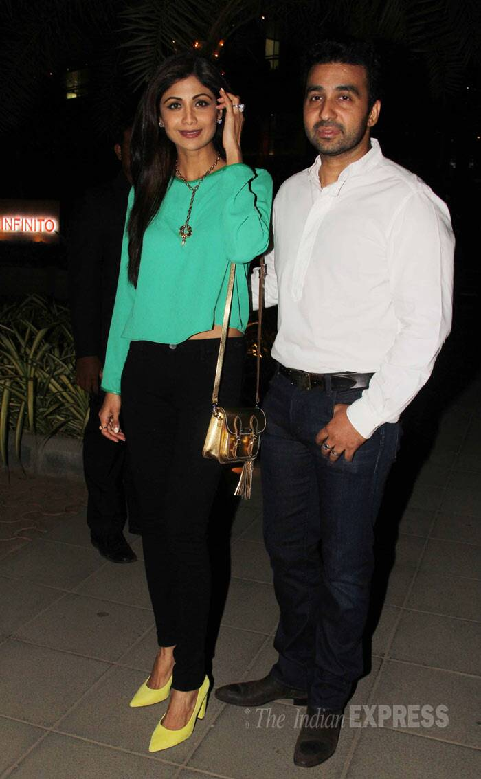 Shilpa Shetty wore a green top with black pants and yellow pumps. Seen here with her husband Raj Kundra post dinner. (Photo: Varinder Chawla)