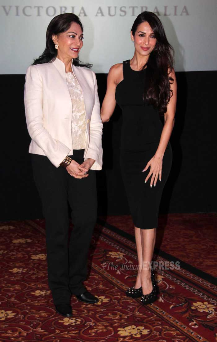 Simi Grewal wore a lace blouse with a white jacket and black trousers as she posed with Malaika for the cameras. (Photo: Varinder Chawla)