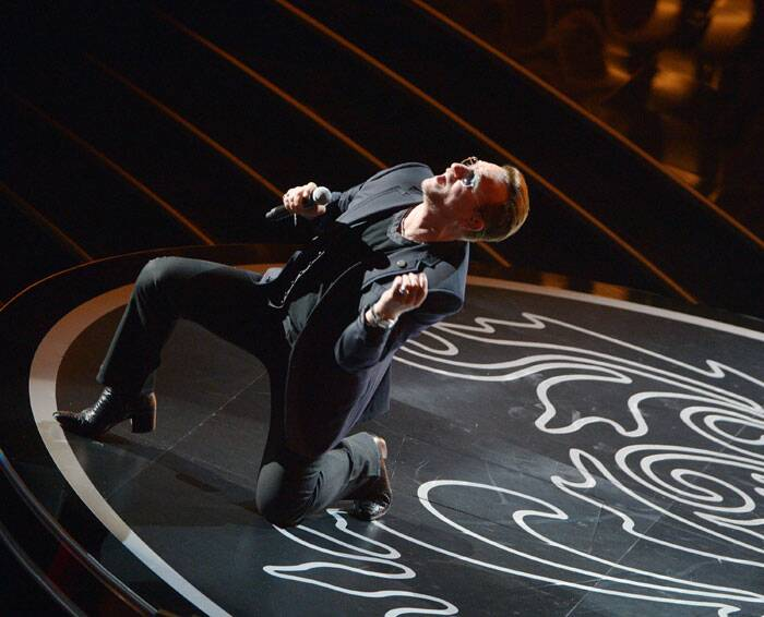 Bono of U2 performs during the Oscars at the Dolby Theatre on Sunday in Los Angeles. U2 performed on Ordinary Love from Mandela: Long Walk To Freedom (AP)