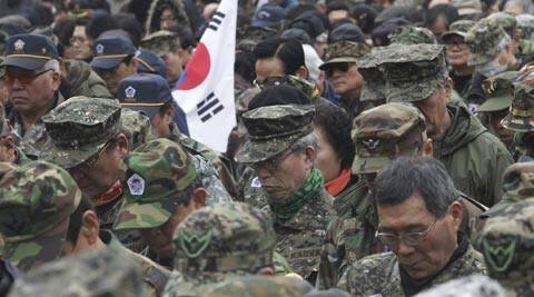 Vietnam War veterans pay a silent tribute during a rally denouncing North Korea's rocket missiles launch, held on the occasion of the March First Independence Movement Day in Seoul. (AP)