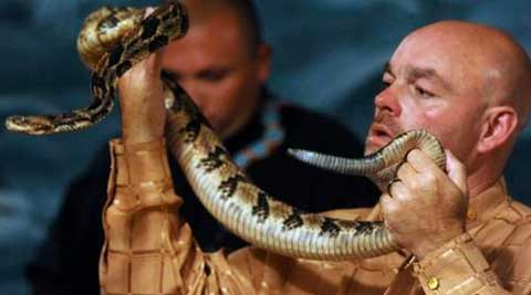 Snake-handling Kentucky pastor Jamie Coots died from a rattlesnake bite at church. (AP Photo)
