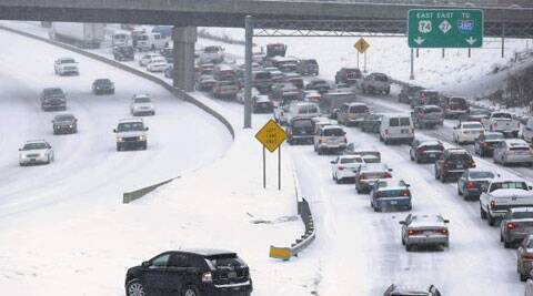 Officials warned people to stay off treacherous roads, and Schools were canceled, and federal government workers in the DC area were told to stay home on Monday. (Reuters)