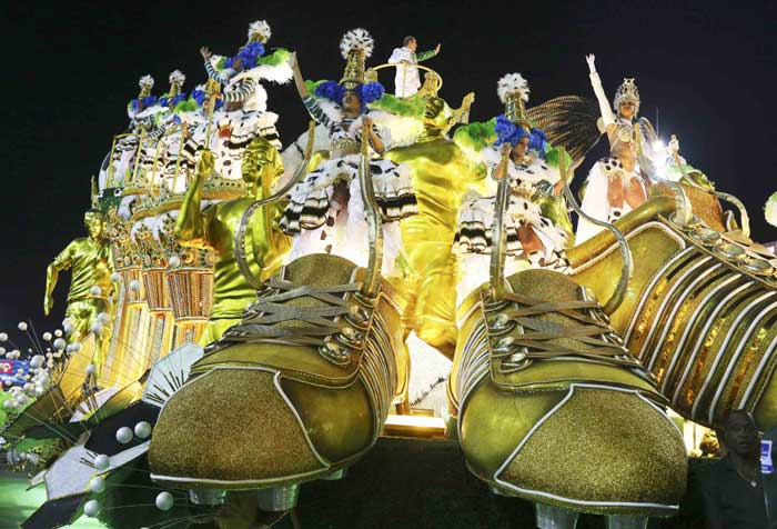 Revellers design a golden float resembling soccer shoes at the Carnival. (Reuters).