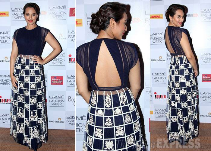 "Sonakshi Sinha shows off her sexy back as she poses for the photogs after the show.  She tweeted: ""Fresh off the catwalk with Manish Malhotra. The magician"" (Photo: Varinder Chawla)"