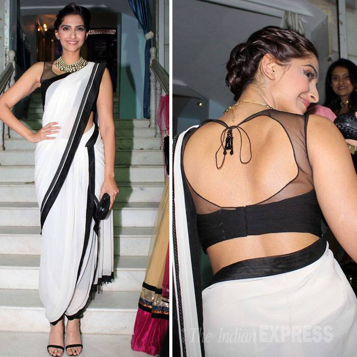 Bollywood's style diva looked uber hot in a Tarun Tahiliani dhoti-sari. Sonam opted to tie her hair in a bun, strappy sandals and spectacular kundan necklace with a Bottega Veneta clutch finished off her looks. We like! (Photo: Varinder Chawla)