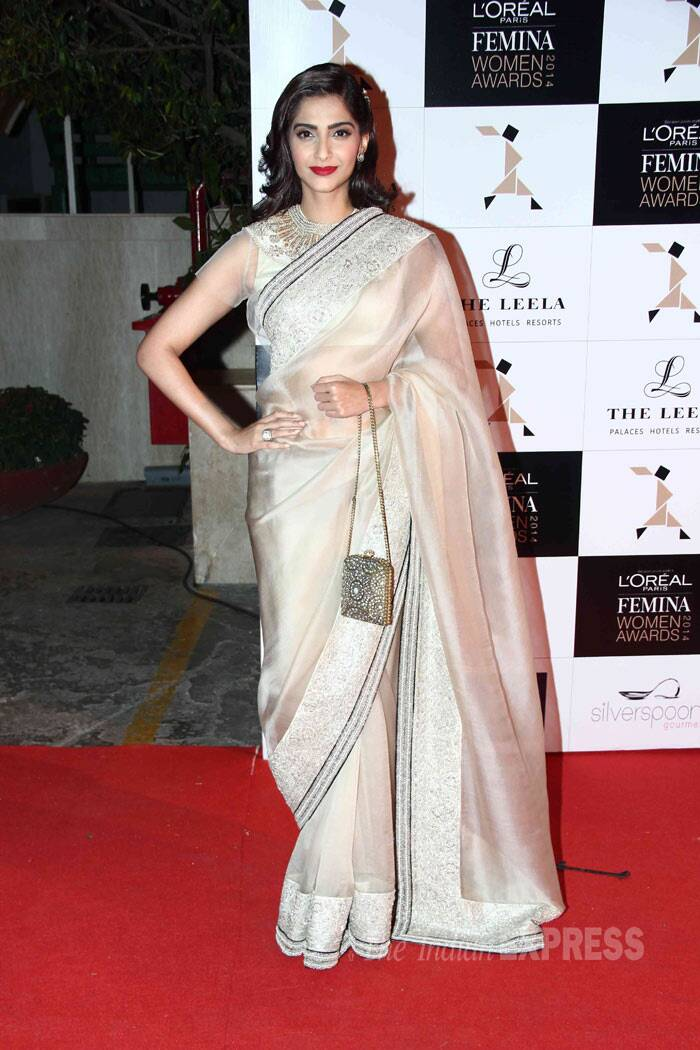 Bollywood's stylista Sonam Kapoor, who is also the face of L'Oreal, has been wearing a lot of Anamika Khanna outfits off late. And here she was seen in another sari by the designer and must say she looked perfect as always. Her sheer blouse had golden embroidery on the neck. (Photo: Varinder Chawla)