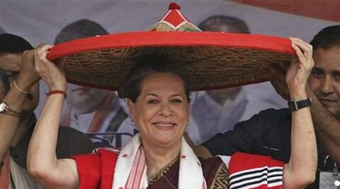 Sonia Gandhi wears Assamese Japi (hat) during an election rally at Lakhimpur on Sunday. (PTI photo)