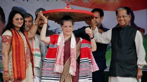 UPA Chairperson Sonia Gandhi being felicitated with traditional Assamese Japi (Hat) by Assam Chief Minister Tarun Gogoi and party leader Ranee Narah during an election campaign rally at North Lakhimpur,Assam on Sunday. PTI