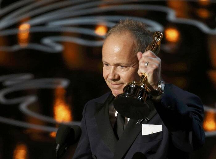 "Glenn Freemantle accepts the Oscar for sound editing for ""Gravity"" at the 86th Academy Awards in Hollywood, California. (Reuters)"