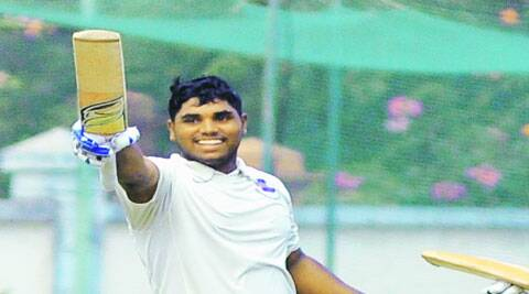 Naik celebrates his double century against Kerala at Thalassery.
