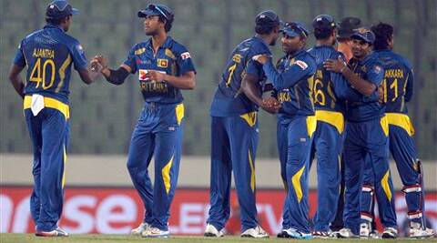 Sri Lankan players celebrate their win over Afghanistan during the Asia Cup one-day international cricket match in Dhaka, Bangladesh, Monday, March 3, 2014. Sri Lanka won the match by 129 runs. AP Photo