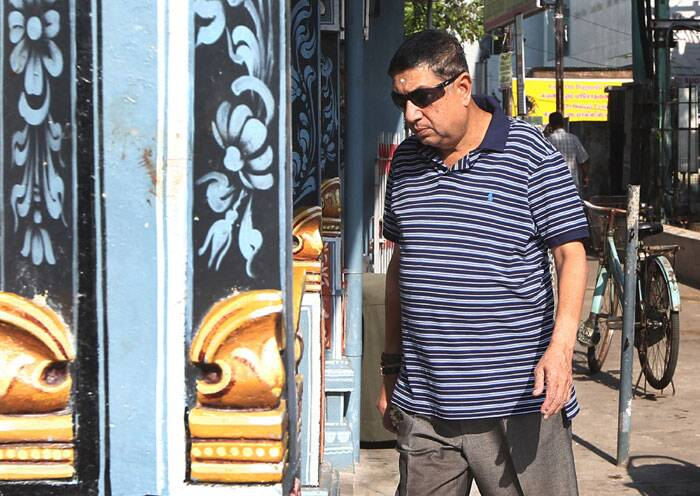 Chairman-designate of the Board of Control of Cricket in India, Narayanaswami Srinivasan, arrives at a temple to offer prayer in Chennai. (AP)