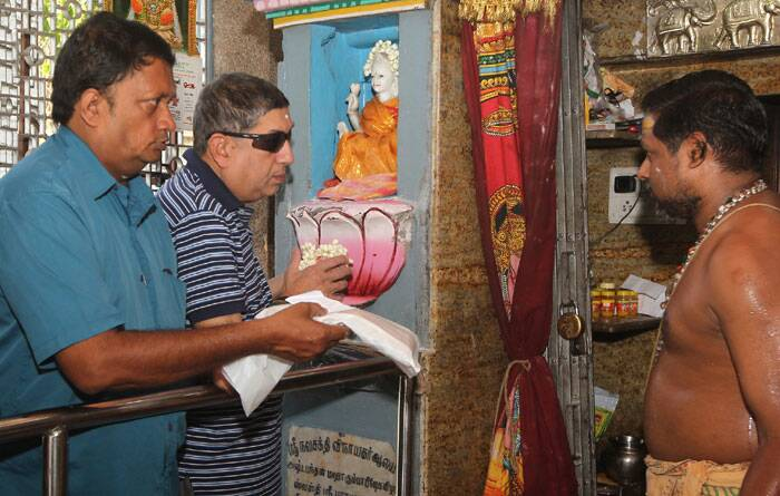 Chairman-designate of the Board of Control of Cricket in India, Narayanaswami Srinivasan, second from left, prayers at a temple in Chennai. <br /> Supreme Court has ordered cricket boss Srinivasan to step aside amid a corruption probe. The court said Friday test great Sunil Gavaskar should be a temporary replacement for Srinivasan to lead the Board of Control of Cricket in India until the completion of an investigation into corruption in a domestic Twenty20 league. (AP)
