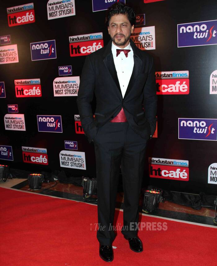 Bollywood's Badshah Shah Rukh  Khan was regal in his 3 piece suit with a maroon waist belt and bow tie for the event. We like how King Khan makes his forever black suit even more interesting! (Photo: Varinder Chawla)