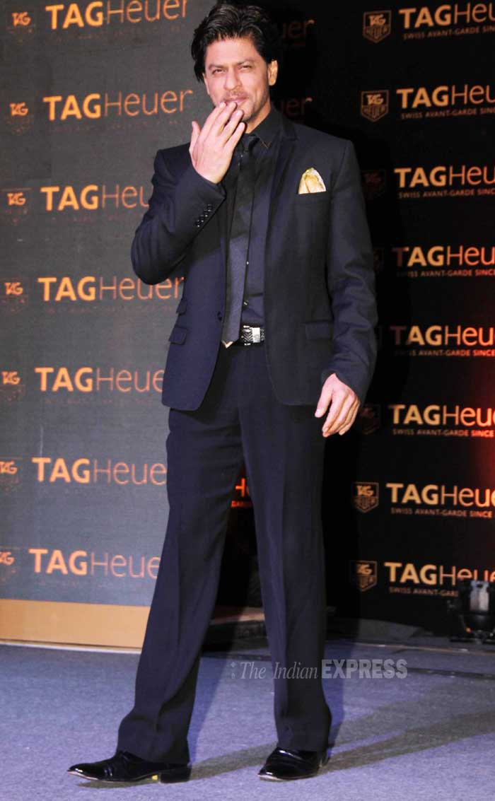 Shah Rukh Khan was his usual dapper self in a black suit. (Photo: Varinder Chawla)