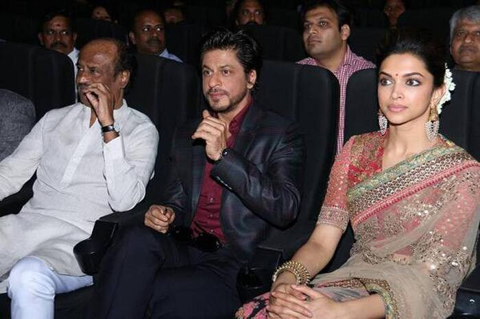 Deepika Padukone opted for a thorough southern style dressing with a pink and black sari. She finished off her look with heavy gold bangles and earrings complete with gajra! <br />Seen here with Rajinikanth and Shah Rukh Khan. (Photo: Twitter)