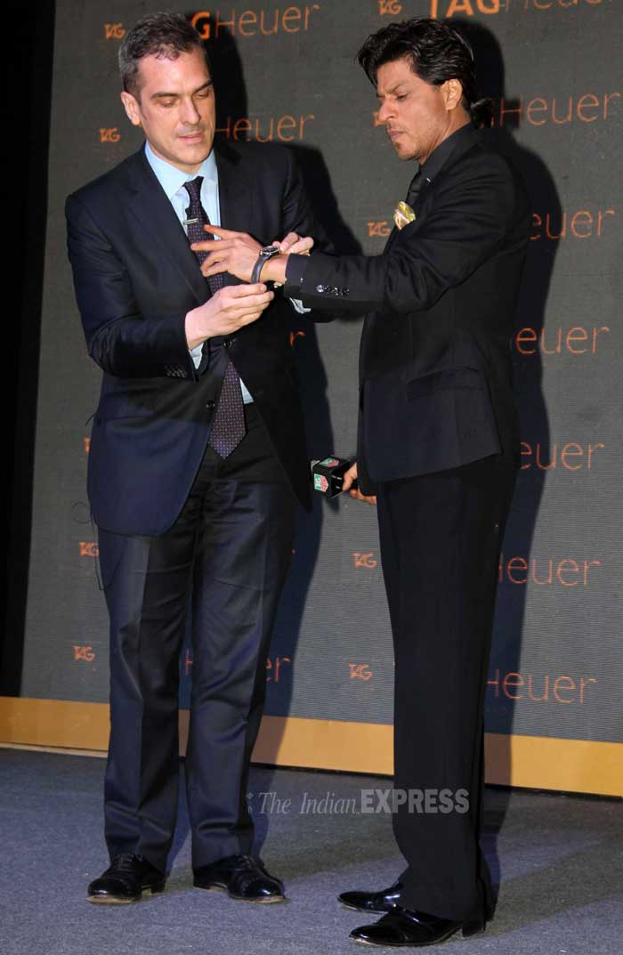 Want this one! SRK  trying one of the designer watches at the launch. (Photo: Varinder Chawla)