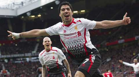 Liverpool's Luis Suarez celebrates after scoring against Manchester United, during their English Premier League soccer match at Old Trafford Stadium, Manchester, England, Sunday, March 16, 2014. (AP Photo)