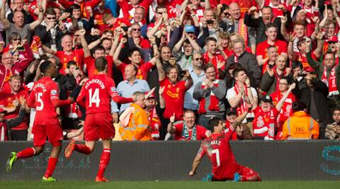 Luis Suarez score the third Liverpool goal, his 29th in the EPL this season, against Spurs at Anfield (AP)